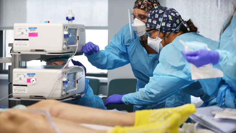 Clinicians work on intubating a COVID-19 patient at Lake Charles Memorial Hospital on Aug. 10 in Lake Charles, La. (Mario Tama/Getty Images/CNN)