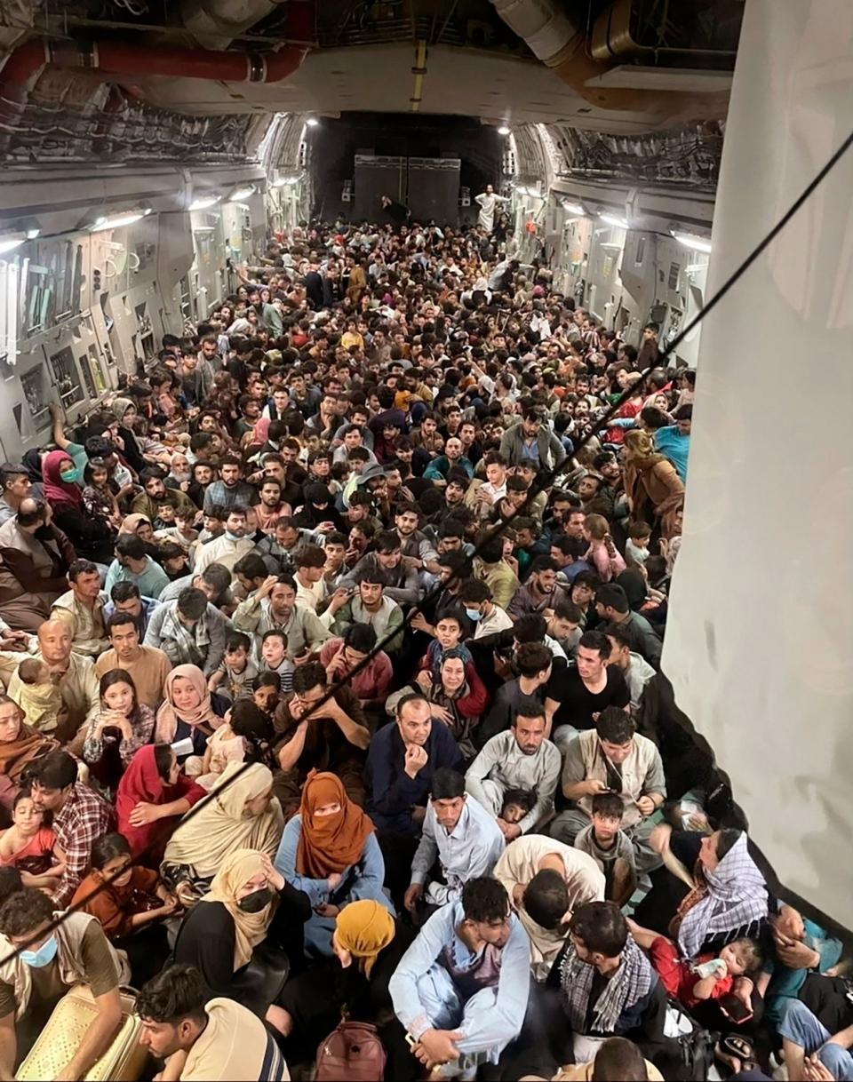 Afghan citizens inside U.S. military plane