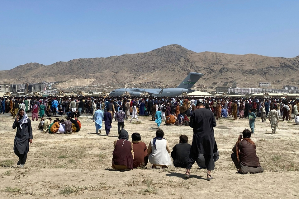 People gather at Kabul airport