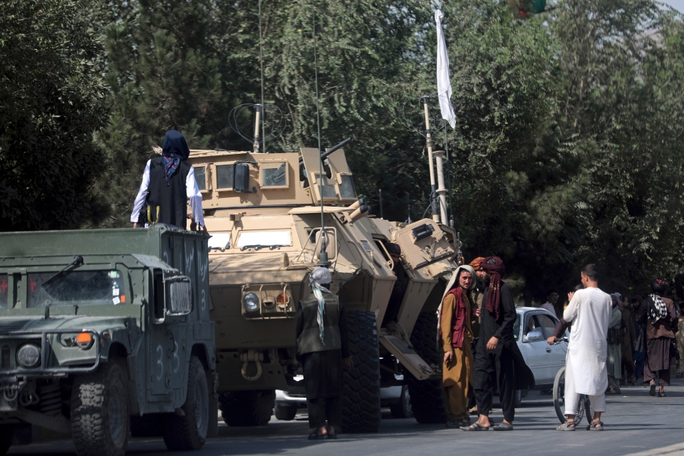 Taliban fighters guard the road to Kabul airport