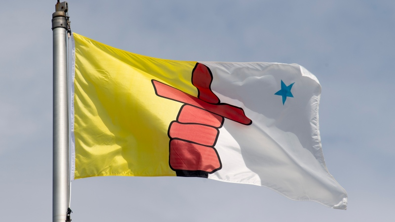 Nunavut's territorial flag flies on a flag pole in Ottawa, Tuesday June 30, 2020. THE CANADIAN PRESS/Adrian Wyld