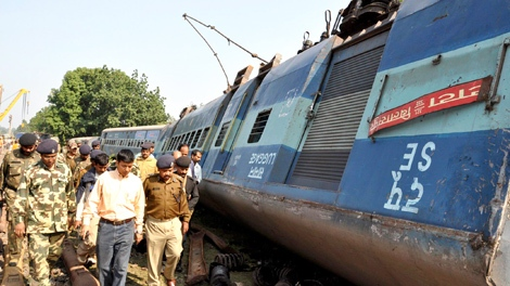 Police officers inspect the site of a train derailment in the forested area of Manoharpur, about 365 kilometers south of Ranchi, in Jharkhand state, India, Friday, Nov. 20, 2009. (AP / Sasanka Sen)