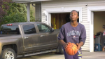 Anthony Muobike shooting hoops after being gifted a basketball net. Tuesday Aug. 17, 2021 (CTV News Edmonton)