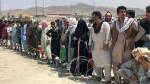 Hundreds of people gather outside the international airport in Kabul, Afghanistan, Tuesday, Aug. 17, 2021. (AP Photo)
