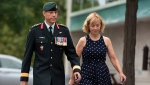 Maj.-Gen. Dany Fortin walks with his wife Madeleine Collin Madeleine Collin as he arrives to be processed at the Gatineau Police Station in Gatineau, Que., on Wednesday, Aug. 18, 2021. THE CANADIAN PRESS/Justin Tang