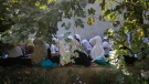 In this 2020 file photo, Afghan students attend an open air class at a primary school in Kabul, Afghanistan. (AP Photo/Mariam Zuhaib, File)