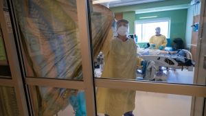 Nurses close the curtains of a patients room in the COVID-19 Intensive Care Unit at Surrey Memorial Hospital in Surrey, B.C., Friday, June 4, 2021. THE CANADIAN PRESS/Jonathan Hayward