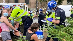 Paramedics administer aid to people who were pepper sprayed at protests that erupted Wednesday in Halifax after city staff removed several temporary homeless shelters across the city. (Photo via Todd Battis / CTV Atlantic)