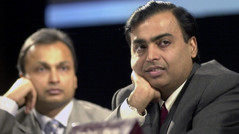In this June 24, 2004 file photo, Reliance Industries Chairman Mukesh Ambani, right, and Vice Chairman Anil Ambani, left, listen to a share holder at the 30th annual general meeting in Mumbai, India. Anil and his brother Mukesh -- ranked by Forbes magazine as the world's 34th and 7th richest individuals -- are locked in an increasingly bitter fight over India's biggest natural gas deposit. (AP Photo/Rajesh Nirgude, File)