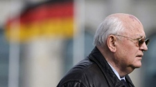Former Soviet leader Mikhail Gorbachev is seen after planting a tree in front of the Reichstag building, prior to the ceremony of the Quadriga awards in Berlin, Saturday, Oct. 3, 2009. The Quadriga awards honor individuals for their cultural, political and social engagement. (AP Photo/Markus Schreiber)