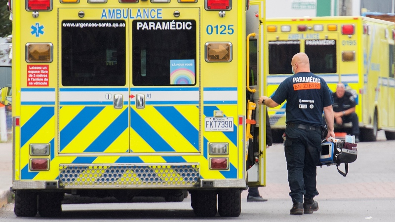 A paramedic is shown next to an ambulance outside a hospital in Montreal, Tuesday, August 17, 2021, as the COVID-19 pandemic continues in Canada and around the world. THE CANADIAN PRESS/Graham Hughes