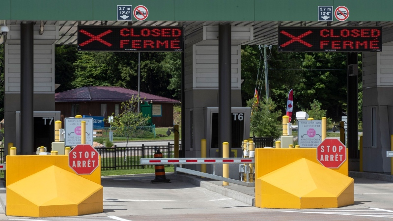 Closed Canada border booths at the Thousand Islands US/Canada border crossing in Lansdowne, Ontario, on Friday July 30, 2021. THE CANADIAN PRESS/Lars Hagberg