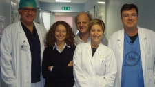 Dr. Paolo Zamboni, right, poses with his team, from left, Dr.Roberto Galeotti, Dr.  Ilaria Bartolomei, Dr.Fabrizio Salvi, and Erica Menegatti. (W5 / Avis Favaro)