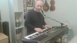 Sudbury's Vic Dupuis is tinkling the piano and singing a country song written by his brother Mike Dupuis. It's called 'Lovely Woman.'