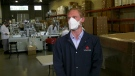 Mikhail Moore, president of Vitacore Industries, wears the newest CAN99 face mask.