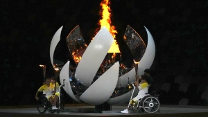 The Paralympic cauldron is lit during the opening ceremony for the 2020 Paralympics at the National Stadium in Tokyo, Tuesday, Aug. 24, 2021. (AP Photo/Emilio Morenatti)