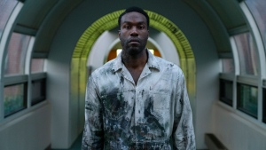 """This image released by Universal Pictures shows Yahya Abdul-Mateen II in a scene from """"Candyman,"""" directed by Nia DaCosta. (Parrish Lewis/Universal Pictures and MGM Pictures via AP)"""