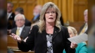 Shelly Glover answers a question during Question Period in the House of Commons on Parliament Hill in Ottawa, Monday March 23, 2015 . THE CANADIAN PRESS/Adrian Wyld