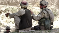 A Canadian soldier takes custody of an Afghan prisoner in the Panjwaii district, May 2006. (Janis Mackey Frayer / CTV)