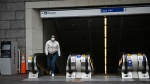 A person wears a face mask as protection against COVID-19 at a Vancouver SkyTrain station. (Shutterstock)
