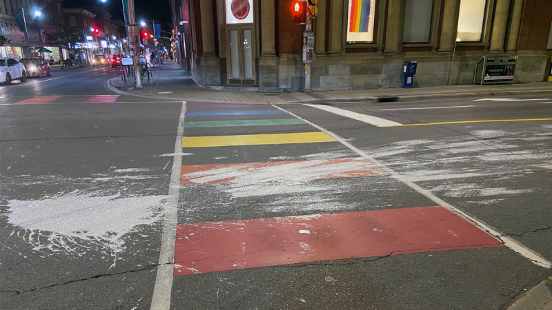 Ottawa police are investigating after paint was apparently splashed and spread across a rainbow Pride crosswalk at Bank and Somerset. (Photo Credit: Matt Elliott)