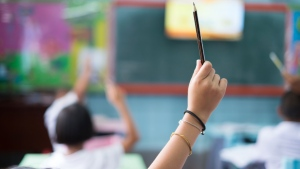 Public health officials in California say an unvaccinated elementary school teacher who took off their mask to read to students ended up infecting more than half of them. (Narongchai Hlawprasert/Adobe Stock Photo/CNN)