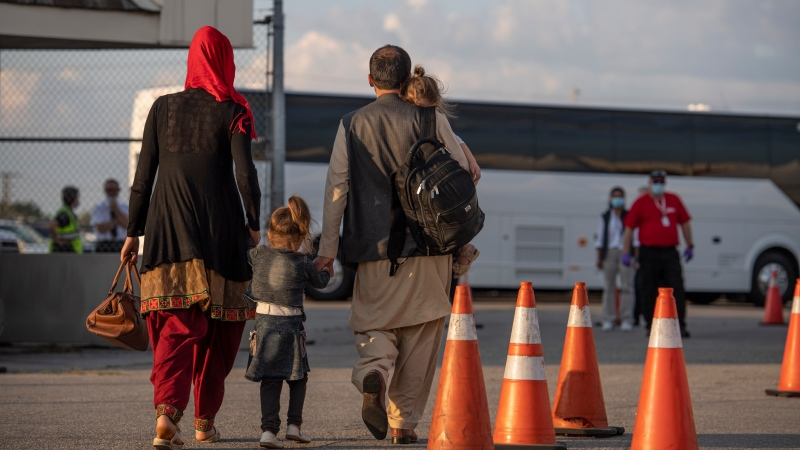 Afghan refugees who supported Canada's mission in Afghanistan arrive at Toronto Pearson International Airport on August 24, 2021. (Source: MCpl Genevieve Lapointe, Canadian Forces Combat Camera, Canadian Armed Forces Photo)