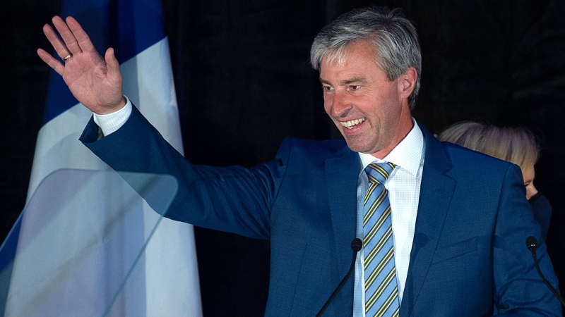 Nova Scotia Progressive Conservative leader Tim Houston waves to supporters after winning a majority government in the provincial election at the Pictou County Wellness Centre in New Glasgow, N.S. on Tuesday, Aug. 17, 2021. THE CANADIAN PRESS/Andrew Vaughan