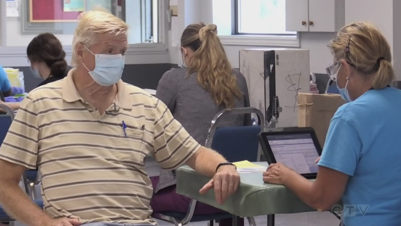 A man receives a COVID-19 vaccine at a pop up clinic at Moose Lodge in Orillia, Ont. on Mon. Aug. 30, 2021 (Siobhan Morris/CTV News)