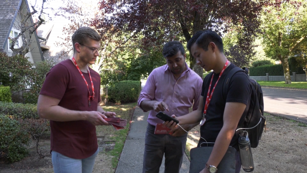 Liberal candidate Taleeb Noormohamed, centre, goes door-knocking in the Vancouver Granville riding he lost to Jody Wilson Raybould in 2019.