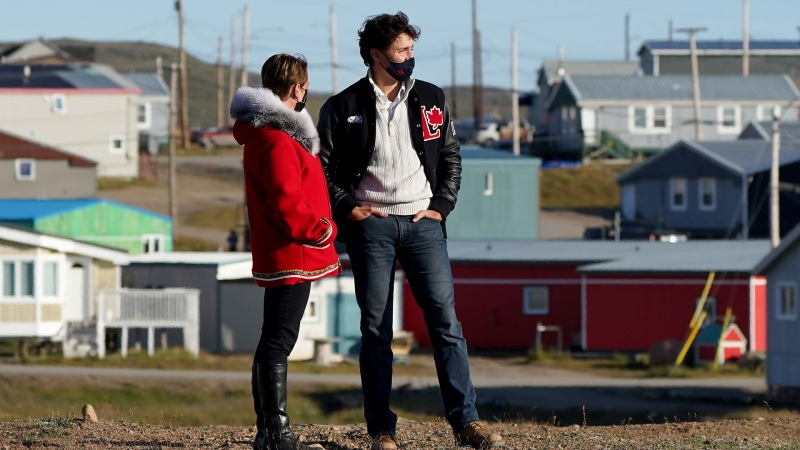 Liberal Leader Justin Trudeau and Liberal candidate Pat Angnakak look on during a campaign stop in Iqaluit, Monday, Aug. 30, 2021. THE CANADIAN PRESS/Nathan Denette