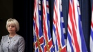 Provincial Health Officer Dr. Bonnie Henry looks on during a press conference about the COVID-19 vaccine card set to arrive in mid-September during a press conference at provincial legislature in Victoria, Monday, Aug. 23, 2021. THE CANADIAN PRESS/Chad Hipolito
