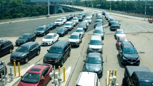 Cars wait on the Rainbow Bridge before crossing the border into Canada in Niagara Falls, Ont., Aug. 9, 2021. THE CANADIAN PRESS/Eduardo Lima