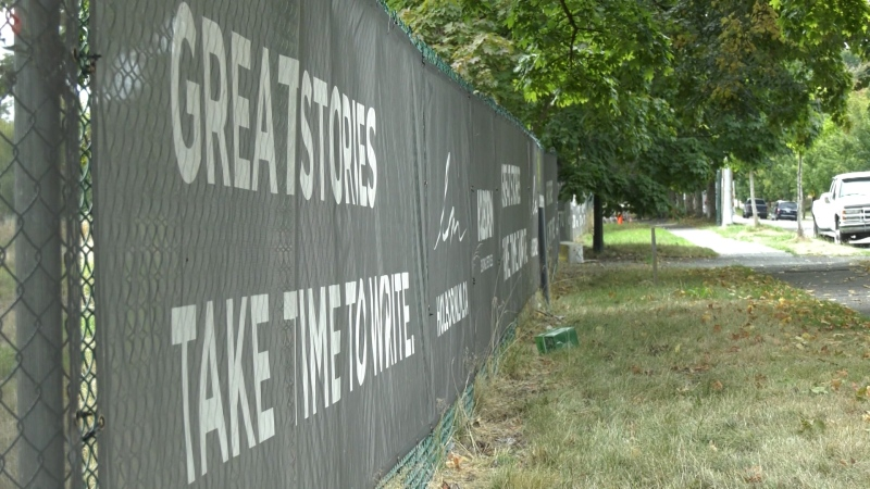 Signs on the fence surrounding Vancouver's Little Mountains lands on Aug. 31, 2021.
