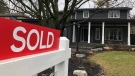 A real estate sold sign is shown in Oakville, Ont., on Sunday, Dec.20, 2020. THE CANADIAN PRESS/Richard Buchan