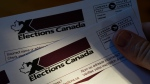 A person holds an Elections Canada voter information card after receiving it in the mail on Tuesday, Aug 31, 2021. THE CANADIAN PRESS/Sean Kilpatrick