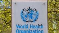 In this April 15, 2020 file photo, the logo and building of the World Health Organization (WHO) headquarters in Geneva, Switzerland. (Martial Trezzini/Keystone via AP, file)