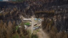 Burnt trees and a property with structures that were destroyed by the White Rock Lake wildfire earlier this month are seen, in Monte Lake, B.C., on Thursday, August 26, 2021. THE CANADIAN PRESS/Darryl Dyck