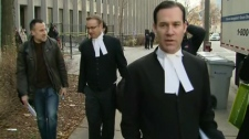 Lawyers Robert Chartier (foreground) and Steven Stauffer outside the University Ave. courthouse on Monday, Nov. 23, 2009.