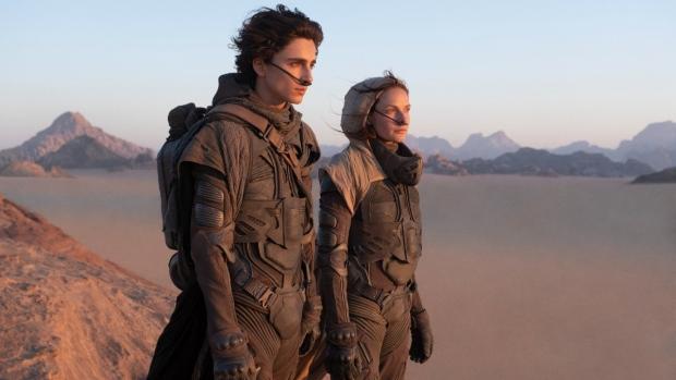Timothee Chalamet, left, and Rebecca Ferguson in a scene the 2021 film 'Dune.' (Chia Bella James / Warner Bros. Entertainment via AP)