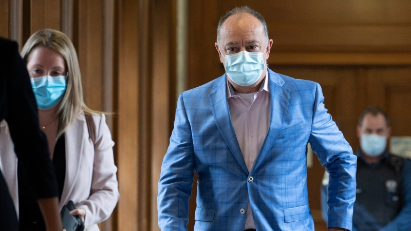 Quebec Health Minister Christian Dube walks to a news conference before entering a cabinet meeting, Wednesday, September 1, 2021 at the legislature in Quebec City. THE CANADIAN PRESS/Jacques Boissinot