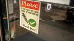 A sign on a business asks for proof of COVID-19 vaccination. (Shutterstock)