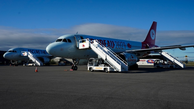 Liberal Leader Justin Trudeau's campaign plane sits on the tarmac next with Conservative Leader Erin O'Toole's plane in Montreal, Que., on Sept. 3, 2021. (Nathan Denette / THE CANADIAN PRESS)