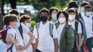 Students line up before attending class on the first day of school in Montreal, Tuesday, August 31, 2021, as the COVID-19 pandemic continues in Canada and around the world. THE CANADIAN PRESS/Graham Hughes