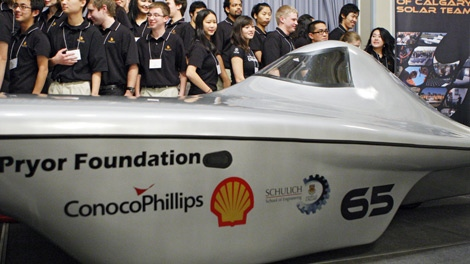 Team members from the University of Calgary's solar car team unveil their new solar race car in Calgary, Monday, Nov. 23, 2009 which will compete in the 2010 American Solar Challenge. (Jeff McIntosh / THE CANADIAN PRESS)