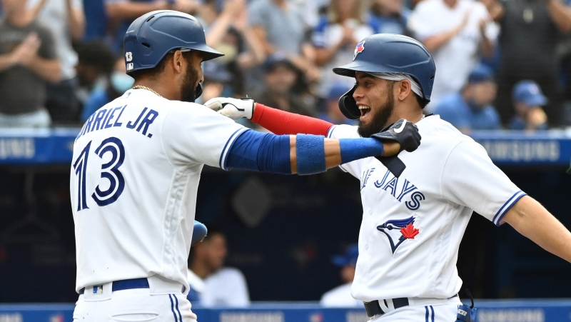 Toronto Blue Jays' Breyvic Valera celebrates his two-RBI home run with Lourdes Gurriel Jr. who also scored, in the fourth inning of an American League baseball game against the Oakland Athletics in Toronto on Saturday, Sept. 4, 2021. THE CANADIAN PRESS/Jon Blacker