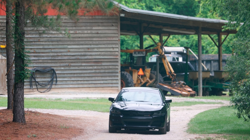 A vehicle sits in the driveway of a home, Tuesday, June 8, 2021, in rural Colleton County, near Islandton, S.C. A mother and son from a prominent South Carolina legal family were found shot and killed on the family's land, and authorities said they have made no arrests in the double homicide case. (Andrew J. Whitaker/The Post And Courier via AP)