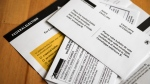 A mail-in voting package that voters will receive if requested is seen in Calgary, Alta., Thursday, Sept. 2, 2021.THE CANADIAN PRESS/Jeff McIntosh