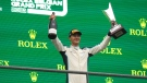 Williams driver George Russell holds his trophy on the podium after the Formula One Grand Prix at the Spa-Francorchamps racetrack in Spa, Belgium, on Aug. 29, 2021. (Francisco Seco / AP)