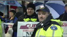 A group of angry paramedics and CUPE members rally outside a downtown Vancouver building on Nov. 23, 2009.